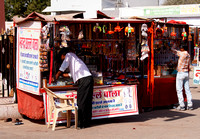 Selling toys and trinkets on market at Deshnoke.