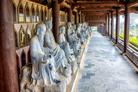 Rows and rows of statues of Buddhist Philosophers or Arhats.
