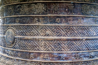 Bas relief at bottom of giant bell at pagoda.