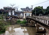 Bridge over canal leading to village Lang Van Hoa.