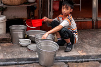 Hanoi: Doing the dishes in the street of Old Quarter.