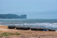 Floating tubs on the shore of the South China Sea.