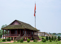 Museum hall in front of stupa with flag.