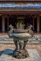 Incense vase in front of hall.