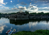 Moat and wall of fort at sunset.