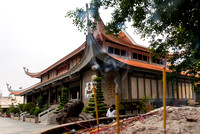 Temple building as seen from behind burning incense.