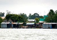 More simple dwellings along the river.