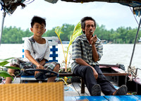 Captain and son of our sampan.