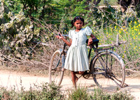 Little girl with big bike.