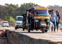 Public taxis also known as took-tooks traverse Orchha bridge.