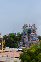 Golden flagstaff and vimanam of temple shrine.