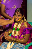 The mother-to-be is loaded with bangles and smeared with pastes.