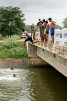 Jumping of the bridge in a canal.