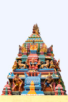 The goddess Durga, symbol of female power, on the top of the vimanam.