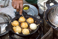Breakfast is almost ready: Kuzhi Paniyaram is the name of the delicatessen.