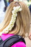 Jasmine flower lei in Claudine's hair, a gift from the women.