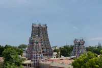 Tallest tower is the South Gopuram. Smaller towers stand inside the temple complex.