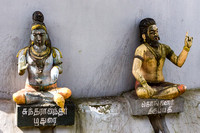 Statues of Hindu gurus on the wall of the Linga.
