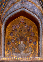Faded mural of vase with flowers at Agra's Baby Taj in India.