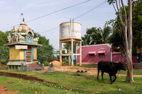 "Small Hindu shrine and water tower create the ""central"" square of the hamlet."