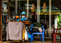 Seamstress in the streets of Hanoi.
