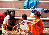 Playing with sisters on the steps of the ghat.