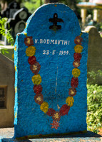 Simple individual tombstone with Shiva symbol.