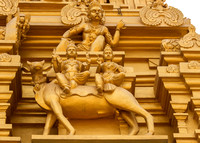 Detail of statues on the golden entrance tower: Shiva and Parvati sitting on the bull.