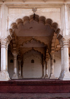 Deep view under arches of royal reception hall at Agra Fort in India.