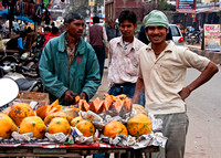 Happy fellows selling fruit in the streets of Agra, India.