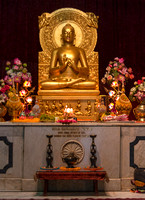 Altar like structure with golden Buddha statue inside the temple.