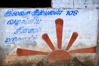 Political symbol painted on the wall of a house.