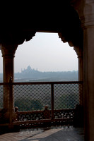Taj Mahal in morning haze seen from Agra's Fort in India.