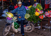 Loaded up on flowers going back to his store.