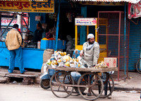 Selling papayas and over ripe bananas in Agra, India.