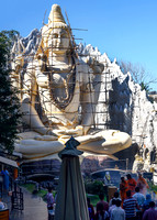 Devotees perform rituals in front of 65 feet tall Lord Shiva statue.