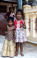 Two girls worshiping at Radnagiri Hill Temple.