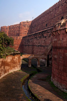 Portrait shot of rampart and empty moat at Agra fort in India.