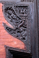 Wood carving incorporated in wall.