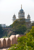 Upper structure of Gwalior's Sikh temple as seen over battlements of fort.