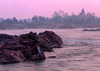 Rocks in the water of the Betwa river just before the sun is up.