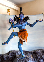 Blue god with multiple arms at the Hare Krishna temple.