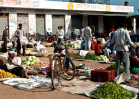 Locals sell their surplus veggies along the street.