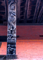 Wood carving on beam holding roof of temple.
