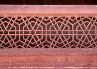 Example of stone carved fence with stars and hexagons.