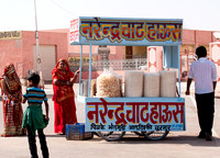 Selling popped grains in front of temple at Deshnoke.