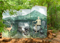 Painting on slabs promoting the Saintly master of the ashram.