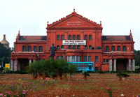She Shadri Iyer Memorial Hall with his statue standing in the rose garden in front.