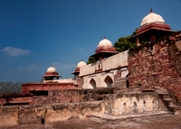 Defensive wall around the fort with some domed structures.