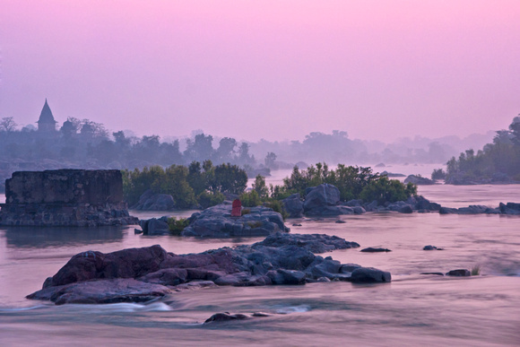 INDIA: Pink skies and pink water in and above the Betwa River before sunrise in Orchha..